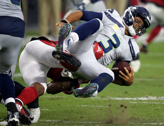 Seattle Seahawks quarterback Russell Wilson (3) is sacked by Arizona Cardinals linebacker Haason Reddick during the first half.