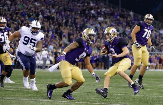 Washington quarterback Jake Browning (3) had one of the best games of his career on Saturday against Brigham Young, thanks in large part to blocking supplied by linemen like Jared Hilbers (70).