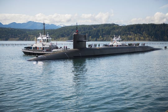 "The Ohio-class ballistic missile submarine USS Henry M. Jackson arrives to its homeport at Naval Base Kitsap-Bangor following a strategic deterrent patrol in 2018. The Ohio-class ballistic missile fleet, including ones based at Bangor, will be getting a new ""low yield"" nuclear weapon on board."