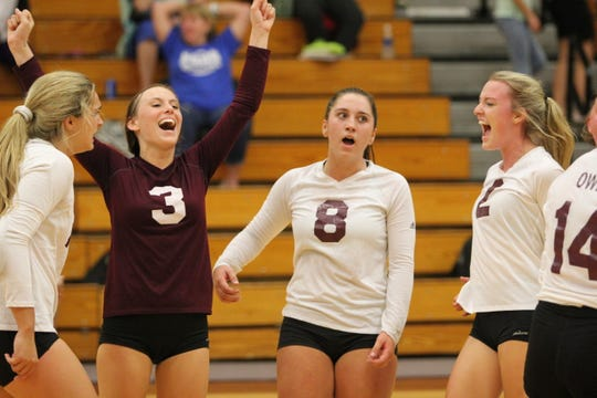 The Owen Warlassies celebrate a point against Western Highlands Conference opponent Polk on Sept. 27.
