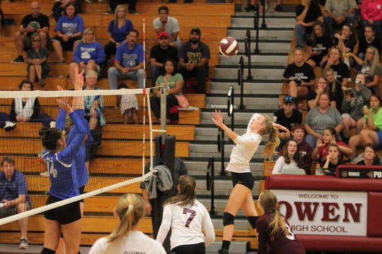 Owen junior Riley Marrett elevates for a spike against Polk at home on Sept. 27.