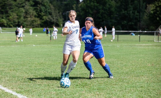 The Owls' Allyson Nestler battles for a loose ball in an 8-2 Owls' victory on Sept. 1.