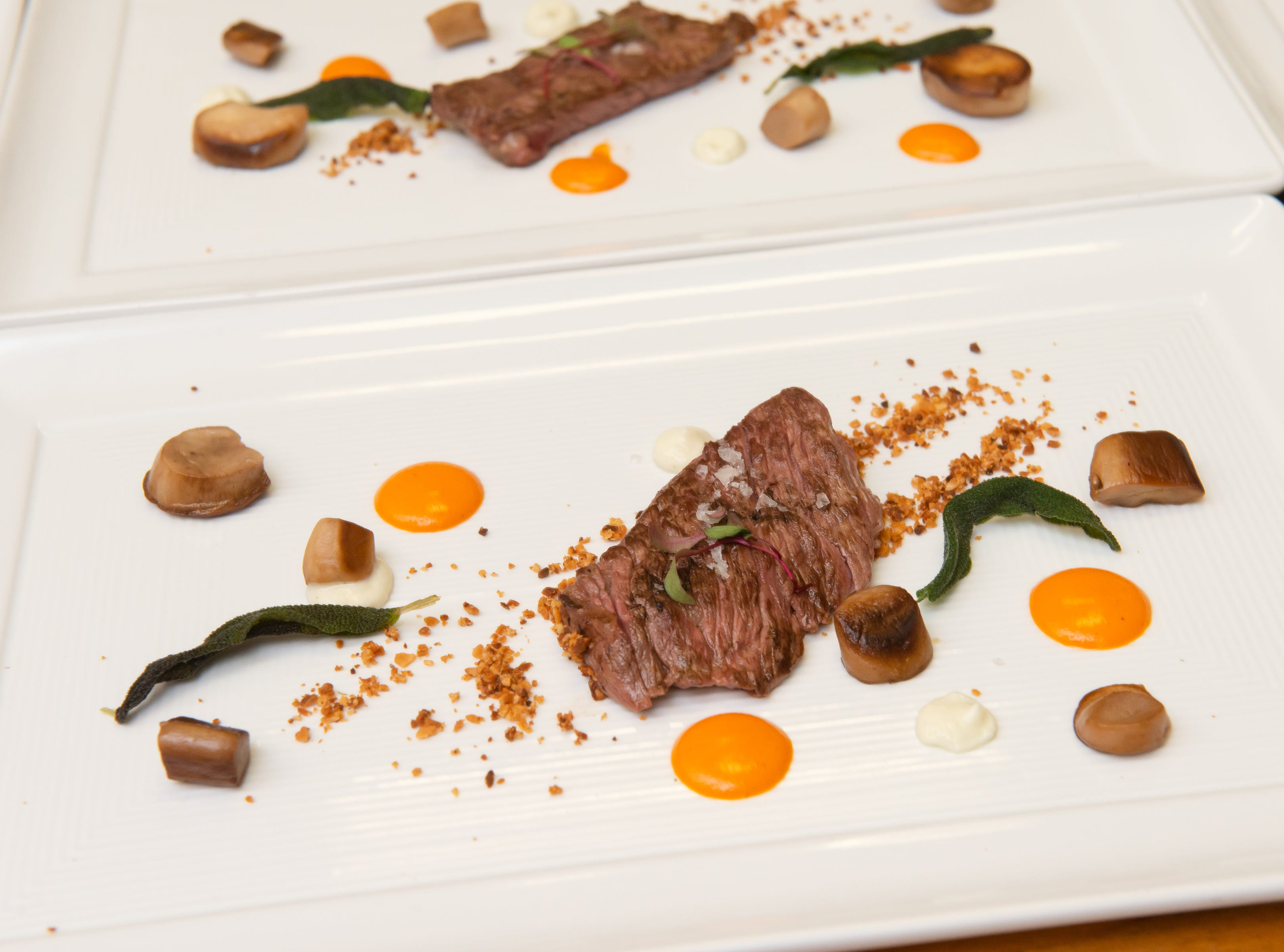 The second course: Wagyu Zabuton, Goat Cheese Sage Cream, Monterey Mushroom Sauteed King Trumpets, Almond Dust, Red Pepper Harissa Sauce and Fried Sage Leaves at the James Beard Foundation Celebrity Chef Dinner held at the Brevard Zoo. (Photo by Amanda Stratford, for FLORIDA TODAY)
