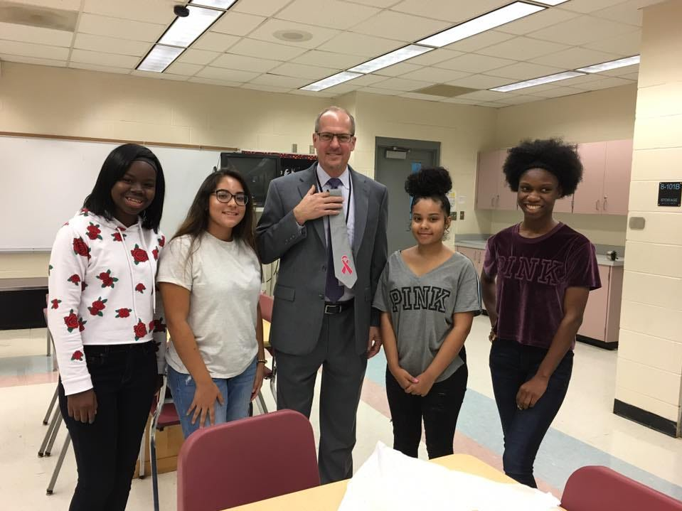 Superintendent Mark Mullins receives ties from fashion design students at Rockledge High School.