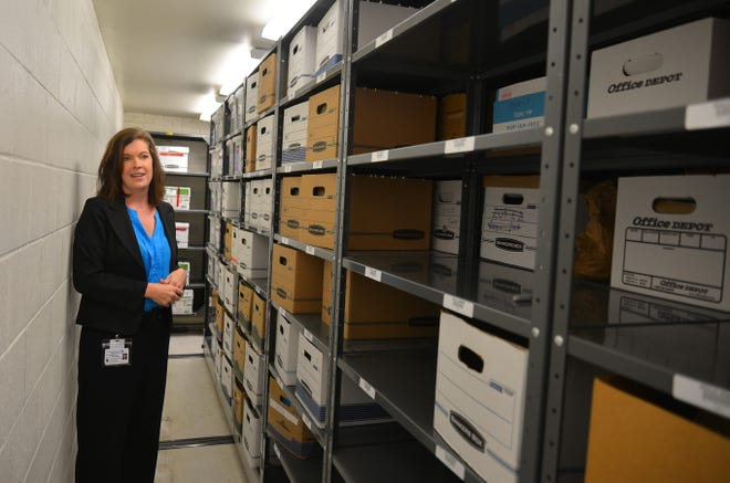 Jessica Bullock, property and evidence supervisor for the Melbourne Police Department, stands in the mold-stricken drug evidence room on Apollo Boulevard.
