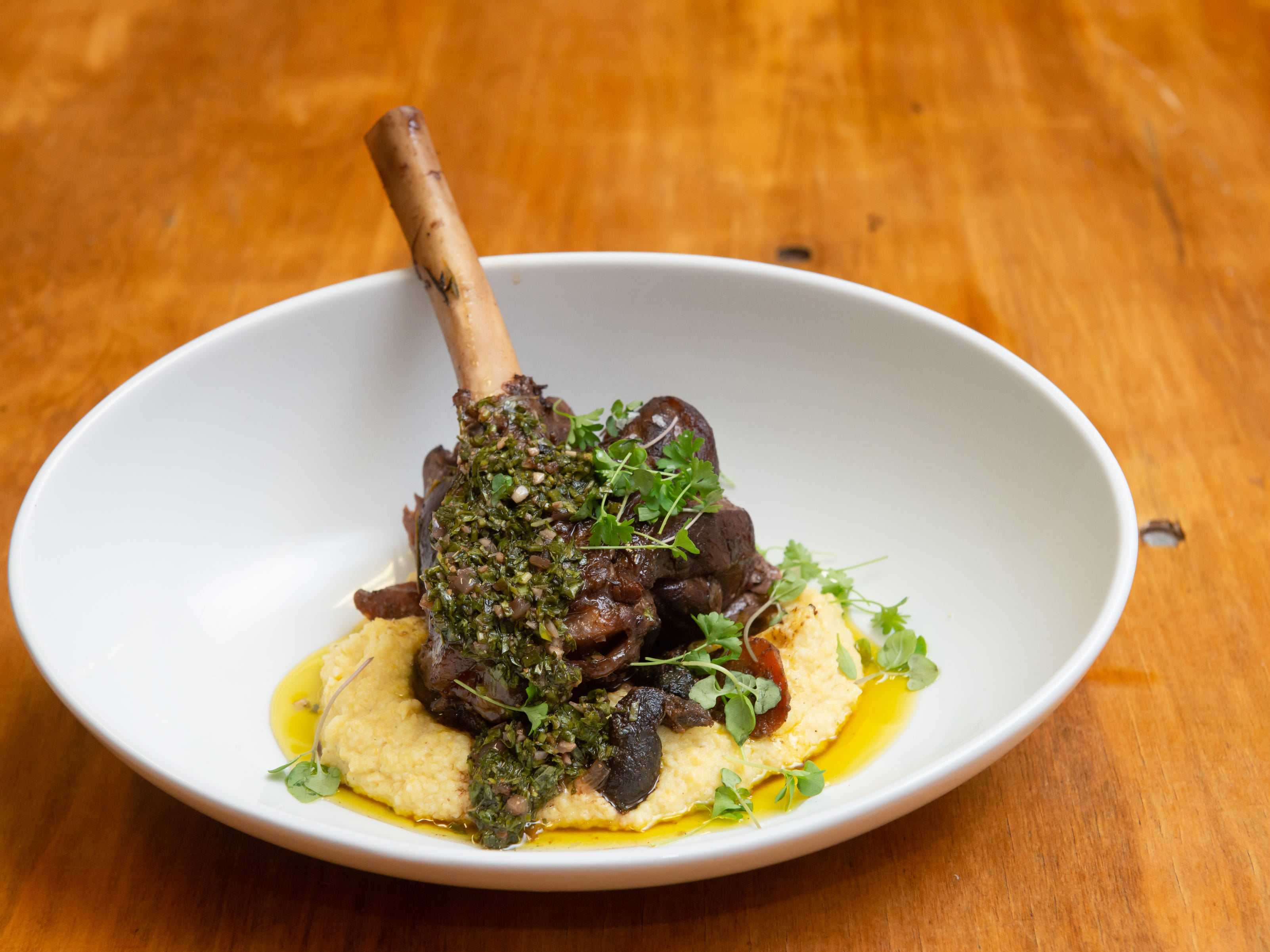 Main Course: Braised  Lamb Shank, Yellow Corn Polenta, Roasted Carrots and Mint Chimichurri at the James Beard Foundation Celebrity Chef Dinner held at the Brevard Zoo. (Photo by Amanda Stratford, for FLORIDA TODAY)