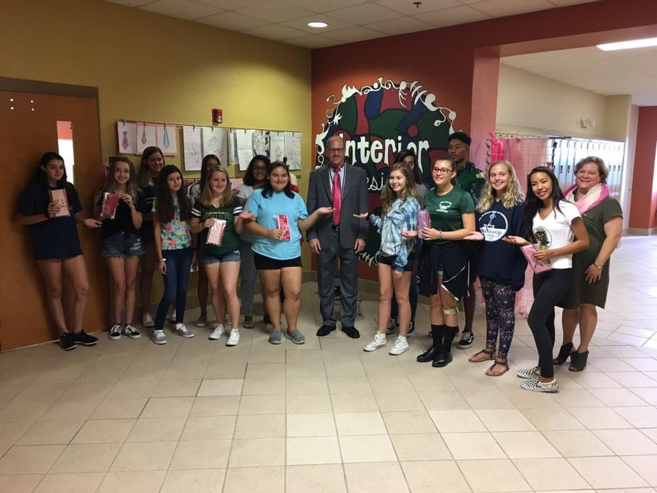 Superintendent Mark Mullins receives ties from fashion design students at Viera High School.