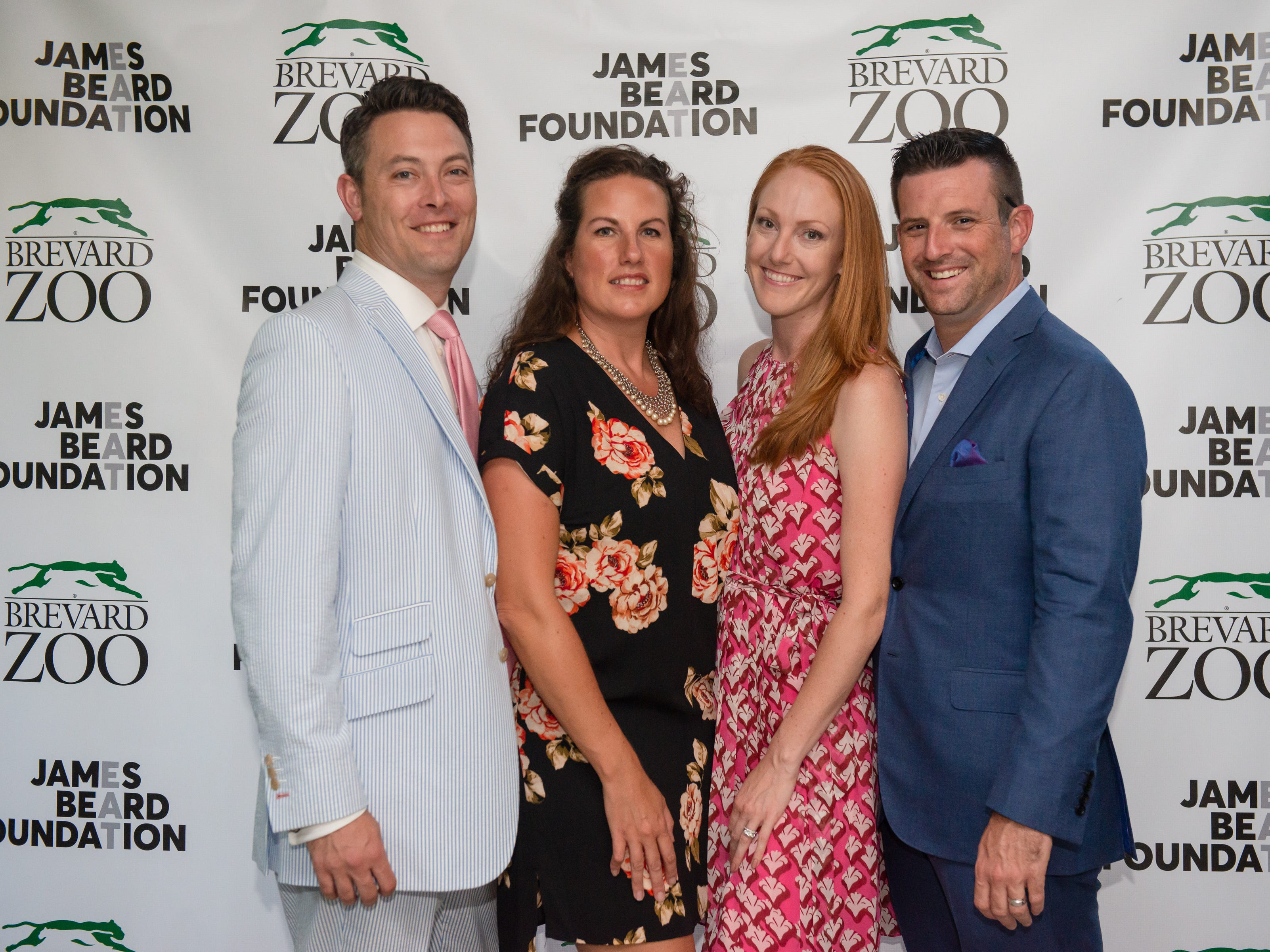 Aaron Hattaway, Robyn Hattaway, Stephanie McLoughlin and PJ McLoughlin at the James Beard Foundation Celebrity Chef Dinner held at the Brevard Zoo. (Photo by Amanda Stratford, for FLORIDA TODAY)
