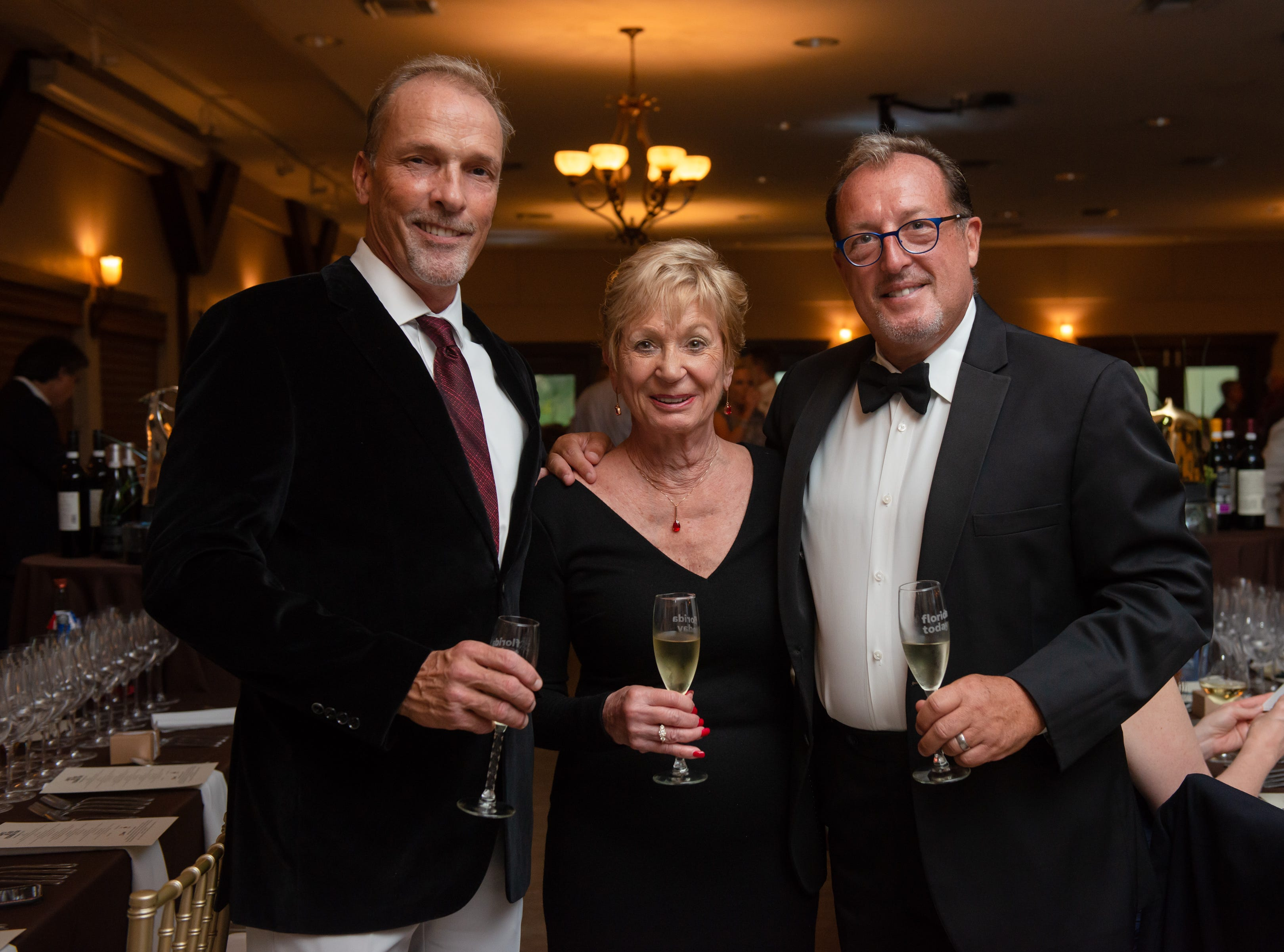 Scott Earick, Hank Hutson and Marilyn Cannon at the James Beard Foundation Celebrity Chef Dinner held at the Brevard Zoo. (Photo by Amanda Stratford, for FLORIDA TODAY)