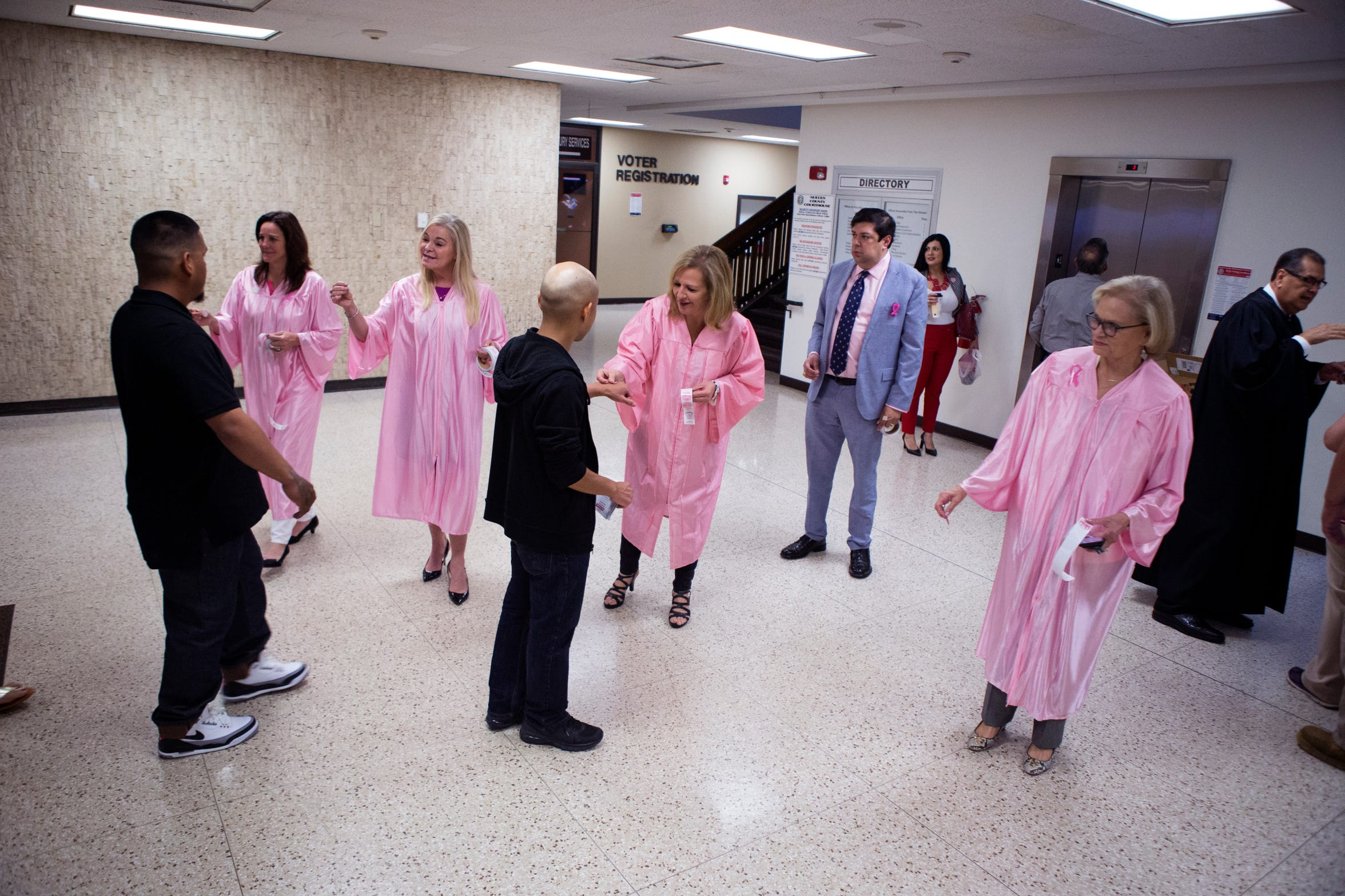 Judges at the Nueces County Courthouse hand out stickers as part of Breast Cancer Awareness Month on Monday, October 1, 2018.