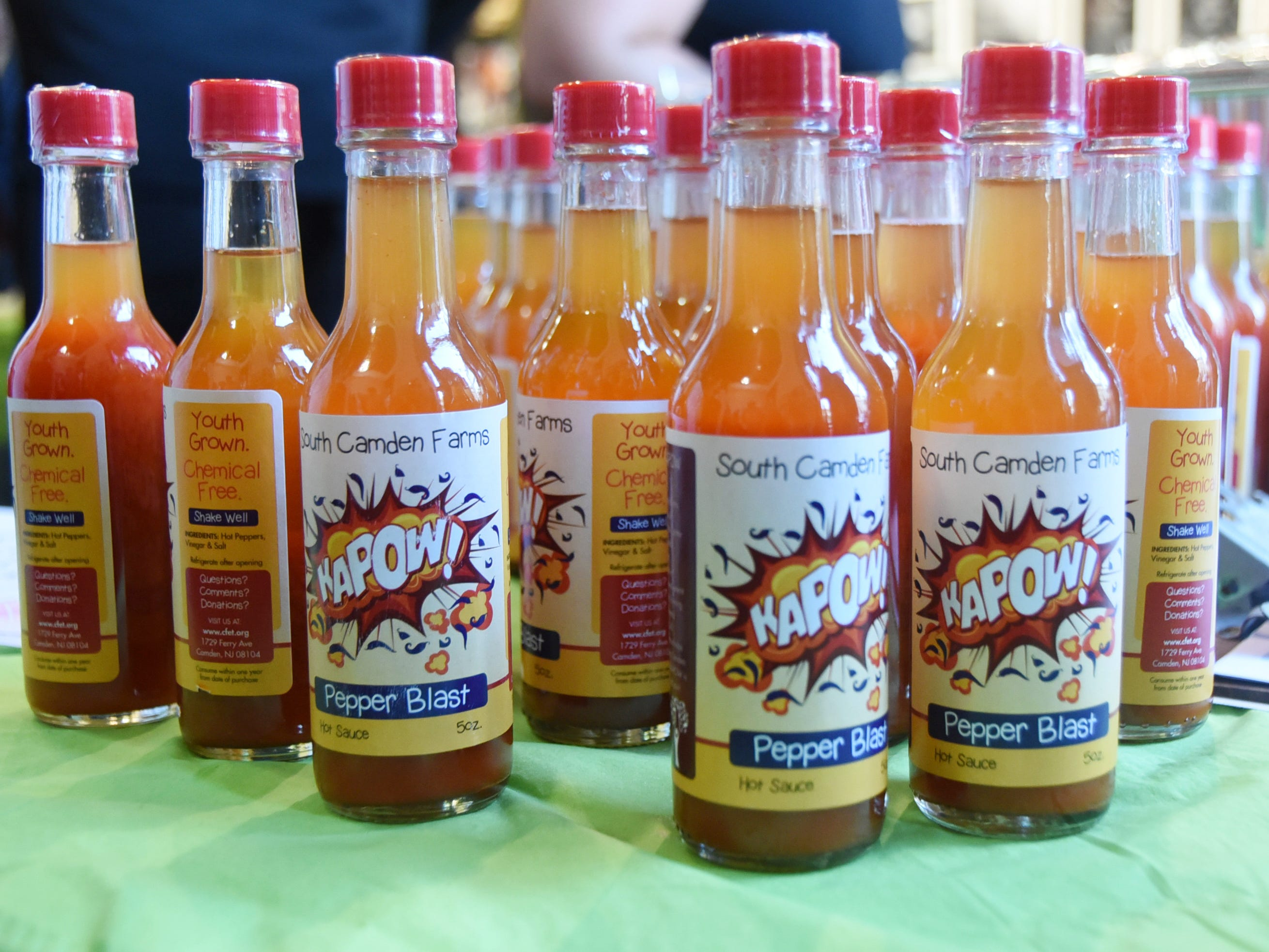 Bottles of hot sauce from South Camden Farms are displayed at the #WasteNot for CFET event at the FireWorks Gallery in South Camden on Saturday, September 29, 2018.  The Courier-Post partnered with the Farm & Fisherman Tavern in Cherry Hill and other community organizations to hold the event that offered a special tasting, farm tour and community conversation about reducing food waste.