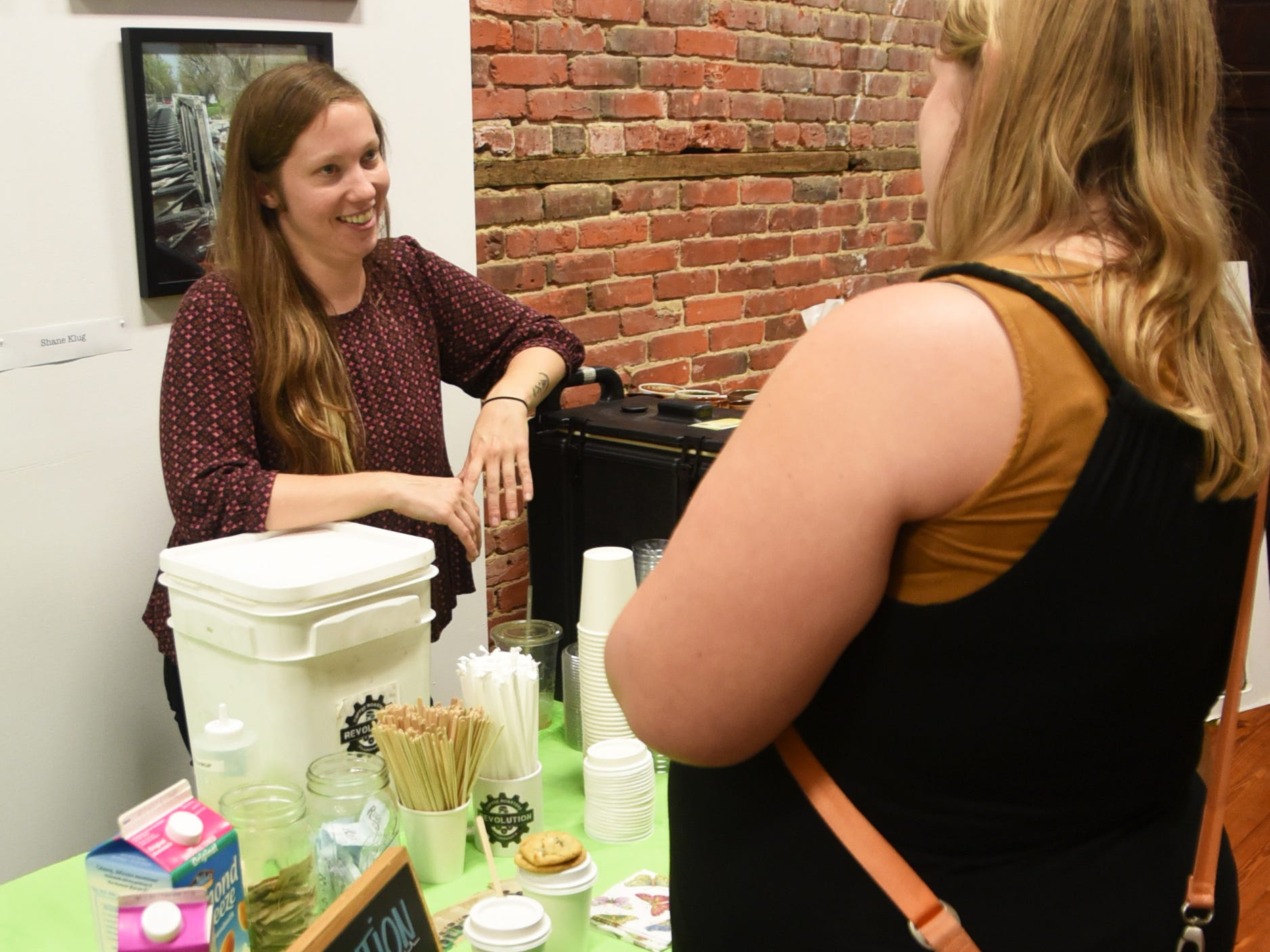Lindsey Ferguson of Revolution Coffee, left, speaks with a guest during the #WasteNot for CFET event at the FireWorks Gallery in South Camden on Saturday, September 29, 2018.  The Courier-Post partnered with the Farm & Fisherman Tavern in Cherry Hill and other community organizations to hold the event that offered a special tasting, farm tour and community conversation about reducing food waste.