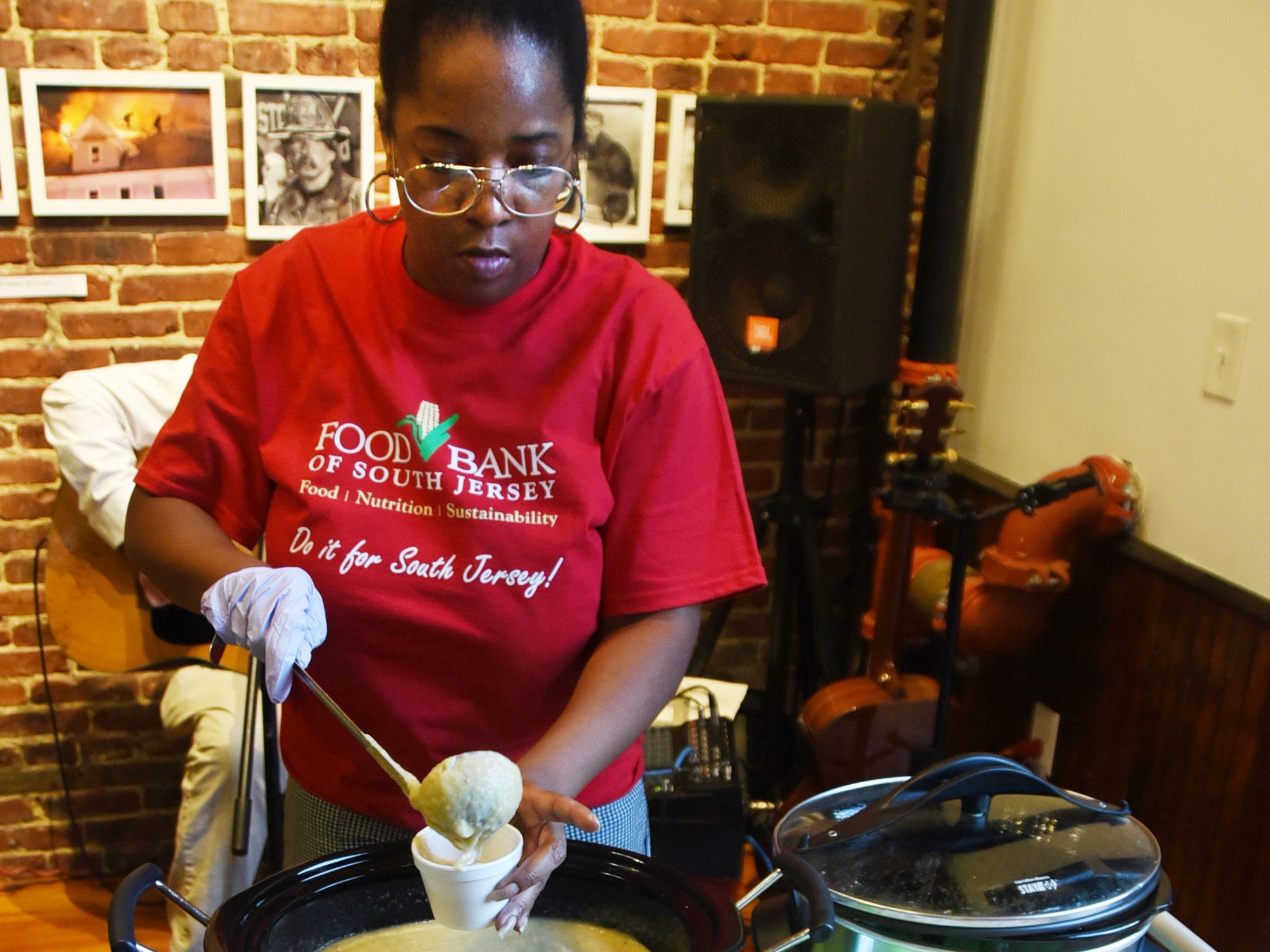 Trina Davis of the Food Bank of South Jersey ladles cauliflower leek soup during the #WasteNot for CFET event at the FireWorks Gallery in South Camden on Saturday, September 29, 2018.  The Courier-Post partnered with the Farm & Fisherman Tavern in Cherry Hill and other community organizations to hold the event that offered a special tasting, farm tour and community conversation about reducing food waste.