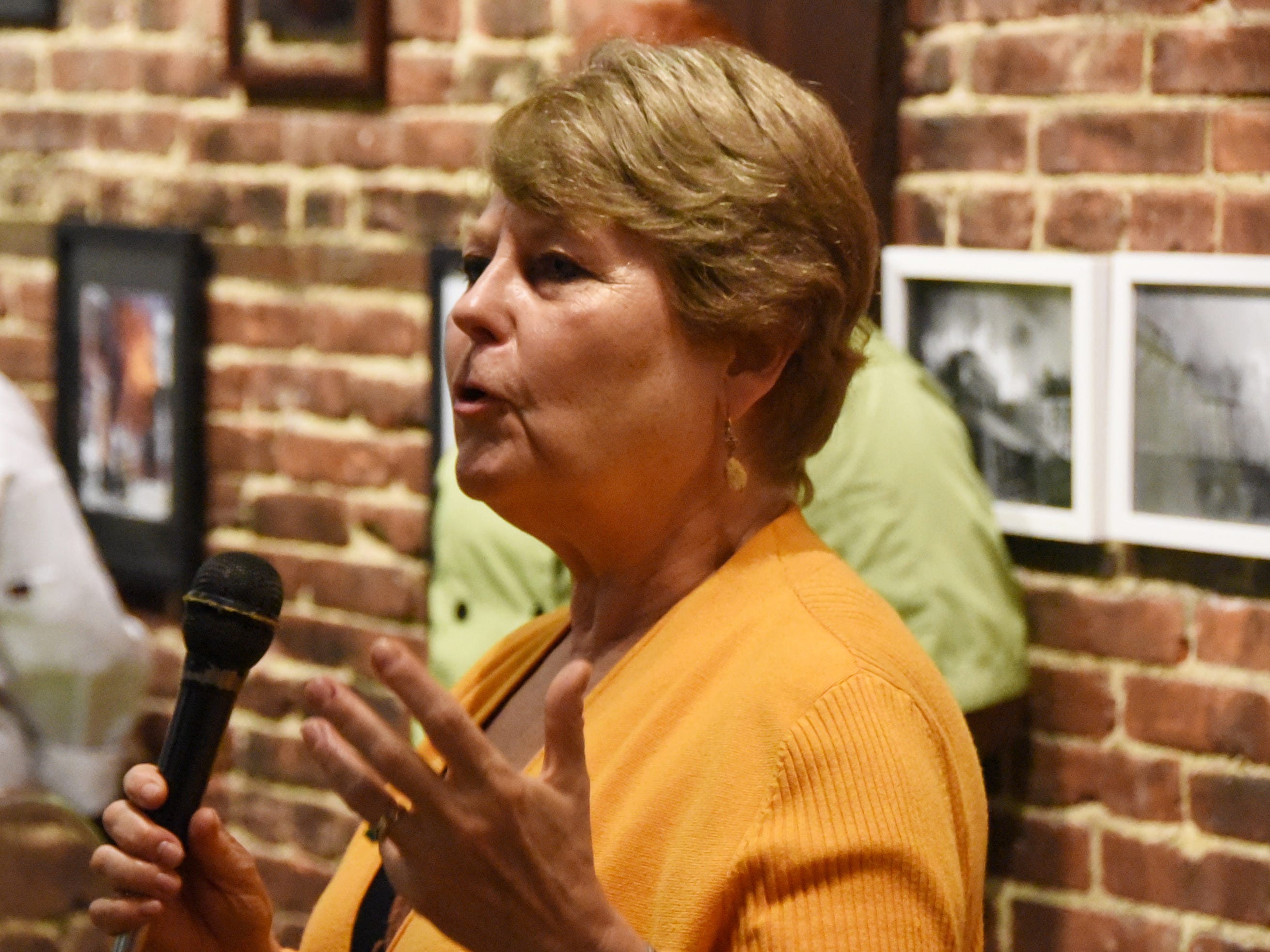 CFET board member Cathy Nevins speaks during the #WasteNot for CFET event at the FireWorks Gallery in South Camden on Saturday, September 29, 2018.  The Courier-Post partnered with the Farm & Fisherman Tavern in Cherry Hill and other community organizations to hold the event that offered a special tasting, farm tour and community conversation about reducing food waste.