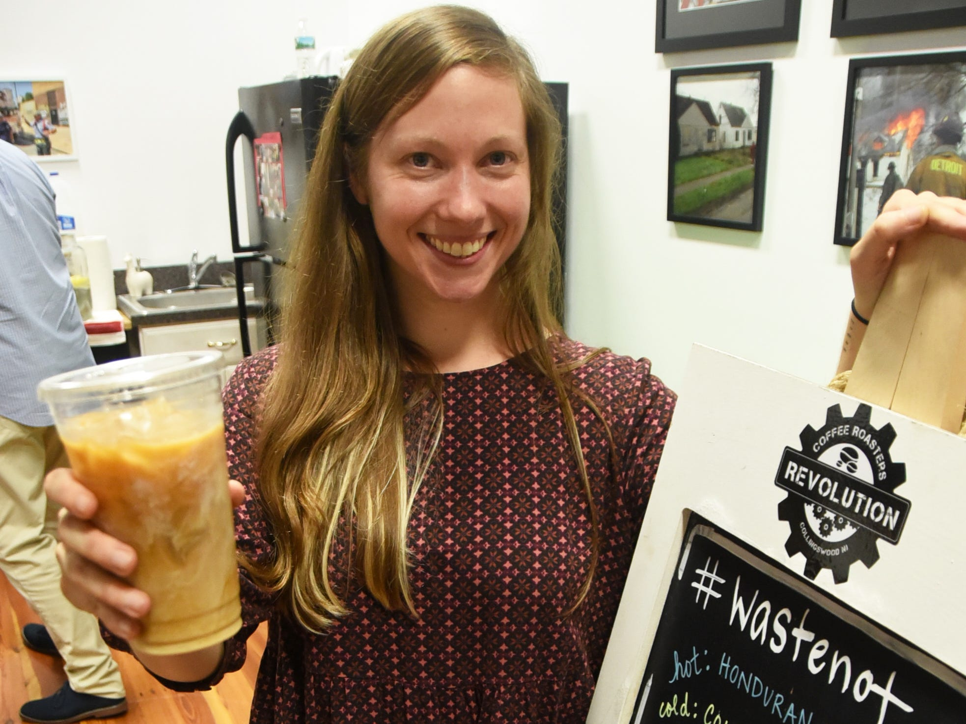 Lindsey Ferguson of Revolution Coffee displays a coffee during the #WasteNot for CFET event at the FireWorks Gallery in South Camden on Saturday, September 29, 2018.  The Courier-Post partnered with the Farm & Fisherman Tavern in Cherry Hill and other community organizations to hold the event that offered a special tasting, farm tour and community conversation about reducing food waste.