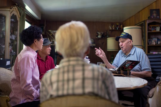 Korean War veteran William Guerriero, 89, (right) discusses his war experience at his Cherry Hill home with the Korean immigrant family who has helped him with his lawn chores since they met years ago. The Lees tend to his lawn as a thank you for his service.