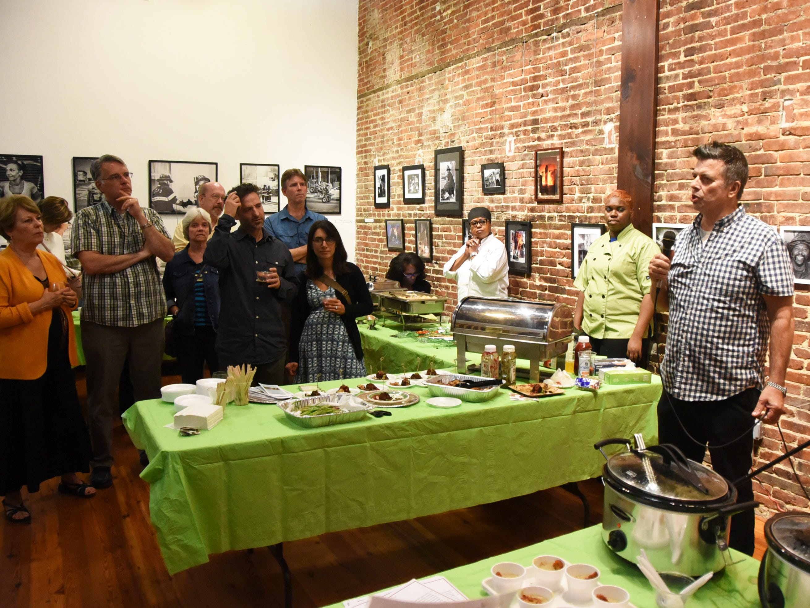 Chef Todd Fuller of the Farm & Fisherman Tavern in Cherry Hill, right, speaks during the #WasteNot for CFET event at the FireWorks Gallery in South Camden on Saturday, September 29, 2018.  The Courier-Post partnered with the Farm & Fisherman Tavern in Cherry Hill and other community organizations to hold the event that offered a special tasting, farm tour and community conversation about reducing food waste.