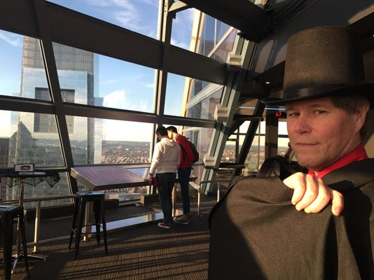 Costumed Rick Stowell of Audubon is one of the guides who leads visitors on ghostly history tours this month atop Philadelphia at One Liberty Observation Deck. One of two Comcast buildings can be seem in the background.