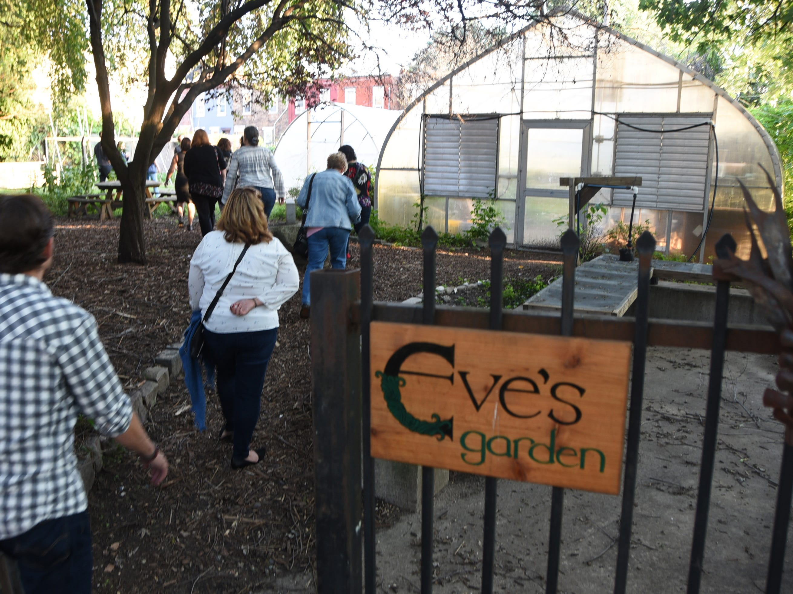 A group tours Eve's Garden in Camden during the #WasteNot for CFET event at the FireWorks Gallery in South Camden on Saturday, September 29, 2018.  The Courier-Post partnered with the Farm & Fisherman Tavern in Cherry Hill and other community organizations to hold the event that offered a special tasting, farm tour and community conversation about reducing food waste.