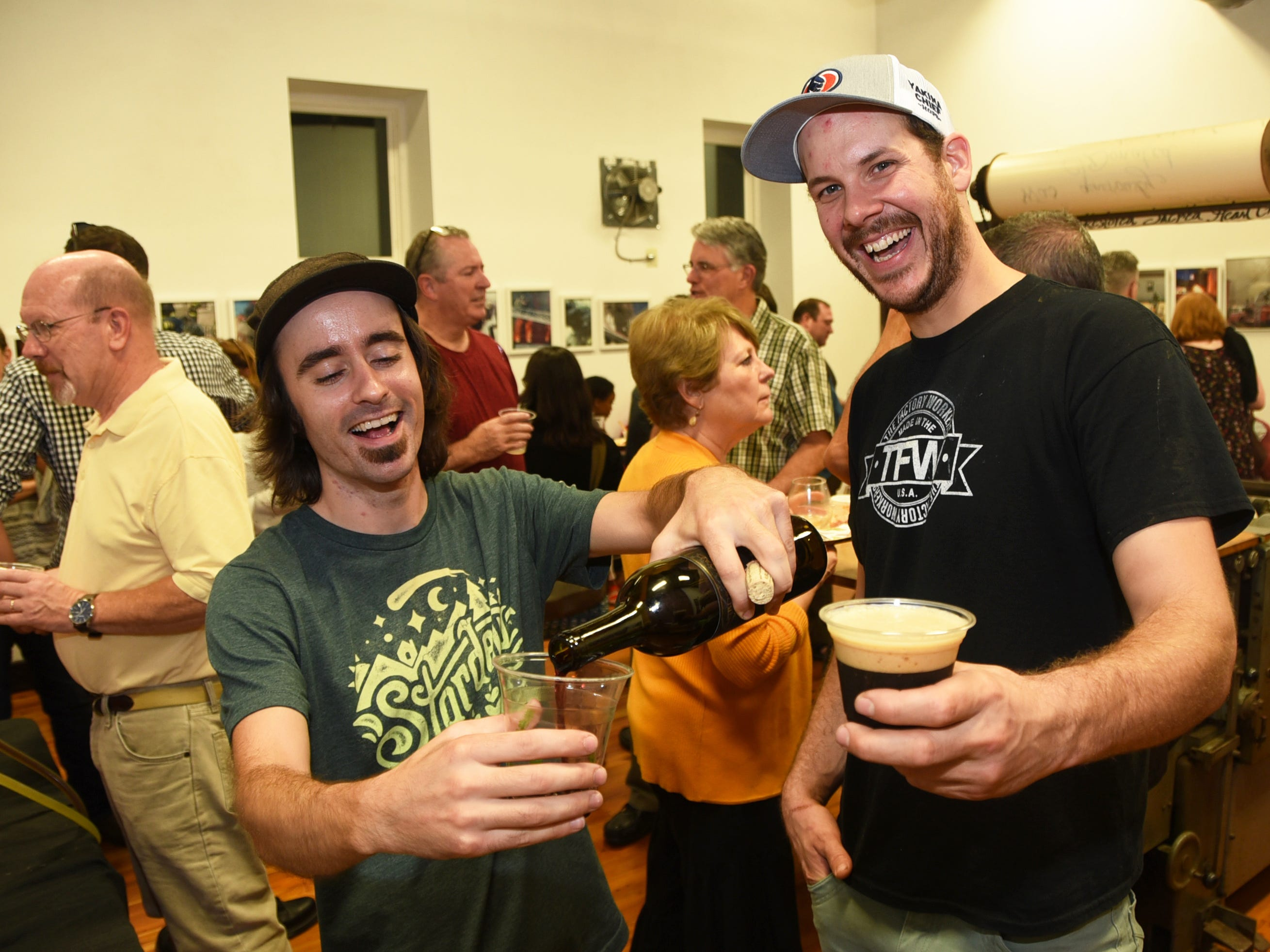 Eric Zola of Auburn Road Winery, left, and Eli Facchinei of Tonewood Brewing attend the #WasteNot for CFET event at the FireWorks Gallery in South Camden on Saturday, September 29, 2018.  The Courier-Post partnered with the Farm & Fisherman Tavern in Cherry Hill and other community organizations to hold the event that offered a special tasting, farm tour and community conversation about reducing food waste.