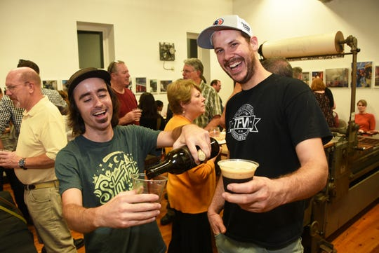 Eli Facchinei, left, of Tonewood Brewing Co. and Eric Zola of Auburn Road Vineyard share a toast at a Courier-Post-sponsored #WasteNot event to support the Center for Environmental Transformation in Camden in 2018. Tonewood's version of Black is Beautiful Stout will support CFET.