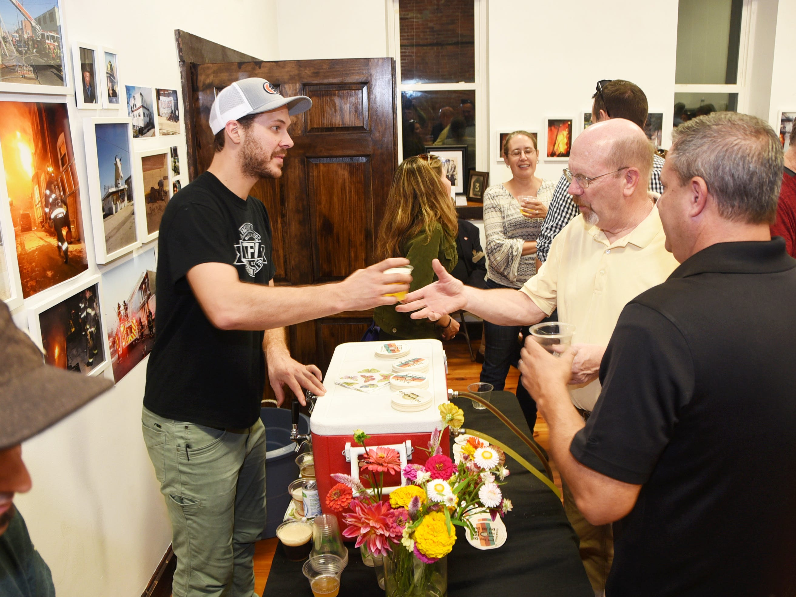 Eli Facchinei of Tonewood Brewing serves beer during the #WasteNot for CFET event at the FireWorks Gallery in South Camden on Saturday, September 29, 2018.  The Courier-Post partnered with the Farm & Fisherman Tavern in Cherry Hill and other community organizations to hold the event that offered a special tasting, farm tour and community conversation about reducing food waste.