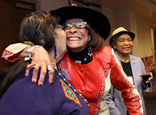 Jeanne Stophlet gets a hug from Emily Spicer, both from the class of 1979, before the 2010 Enquirer Women of the Year luncheon.