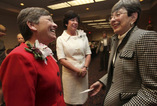 2009 Women of the Year Sue Radabaugh (left) and Brynne Coletti (center) chat with Carol Davidow, class of 1990, (right) at the 2009 Woman of the Year luncheon.