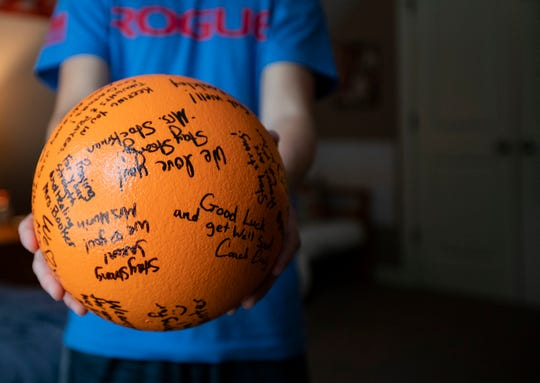 Jaxon Hindman holds the ball that struck him in the head during a dodgeball game at school four years ago, Monday October 1, 2018. Hindman keeps the ball in his bedroom because he believes it saved his life.