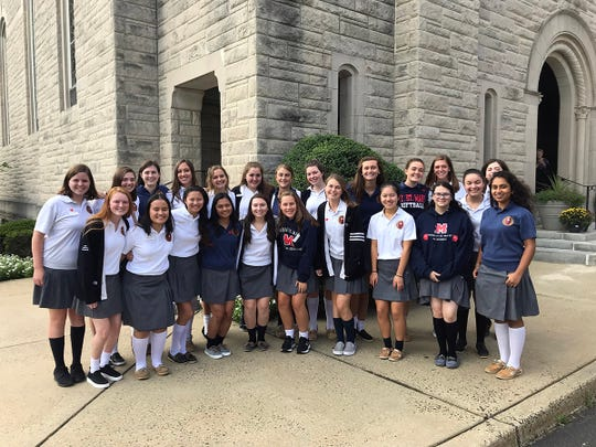 The AP Scholars, AP Scholars with Honor, and AP Scholars with Distinction posed for a photograph on the steps of the Immaculate Conception Chapel at Mount Saint Mary Academy on the afternoon of September 24.