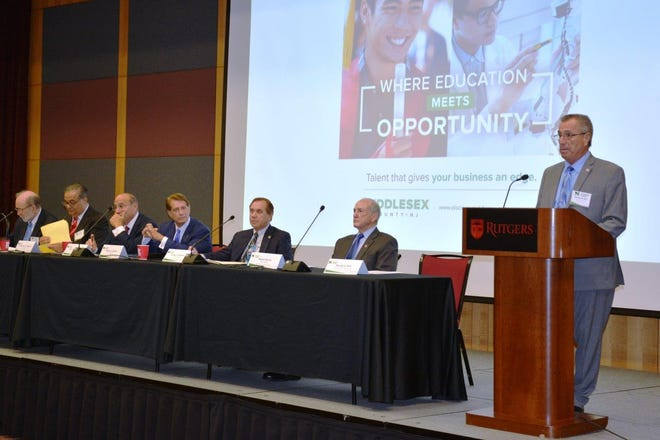 Freeholder Director Rios (right) addresses attendees as the Summit panel looks on. (From left to right): Dr. Carl Van Horn, Rutgers University Distinguished Professor and Director of the Heldrich Center for Workforce Development; Christopher J. Paladino, President of the New Brunswick Development Corporation (DEVCO); Barry H. Ostrowsky, President and CEO of RWJBarnabas Health; Robert C. Garrett, Co-CEO of Hackensack Meridian Health; Assembly Speaker Craig J. Coughlin and Rutgers University President Robert Barchi.