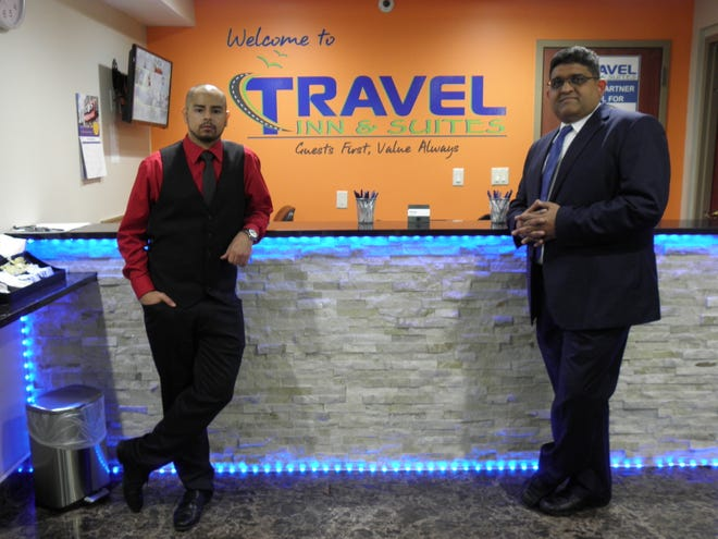 Travel Inn & Suites Owner Mihir Patel, right, and Assistant Manager Farooq Omar in the Flemington motel's remodeled lobby, part of a $1 million modernization and branding initiative.