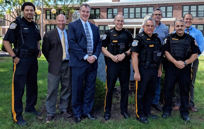 hree new Class III Police Officers will be stationed at North Hunterdon High School in Clinton Township. Pictured here, from left, are Clinton Township Police Detective Thomas Hash (school resource officer), Dr. Richard Bergacs (assistant superintendent), Jeffrey Bender (superintendent), Richard Floyd (Class III Officer), Robert Capece (Class III Officer), Vincent Castellani (Class III Officer), and in rear Jesse Landon (Clinton Township administrator), and Dr. Gregory Cottrell (principal of North Hunterdon High School).