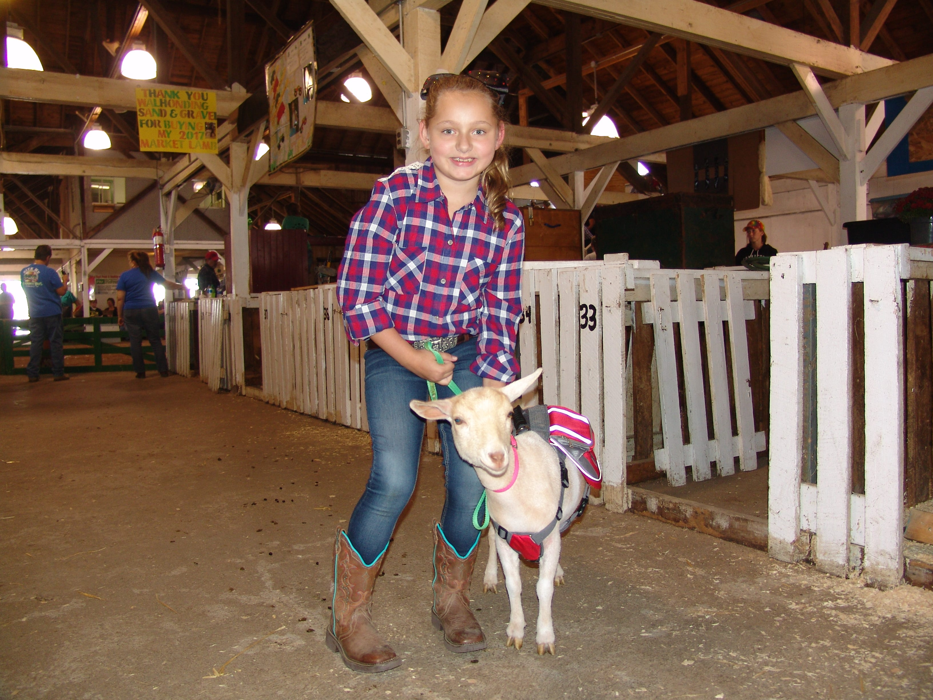 Isabella Crider poses with her dairy goat Abilene before the Jr. Fair Goat Show.