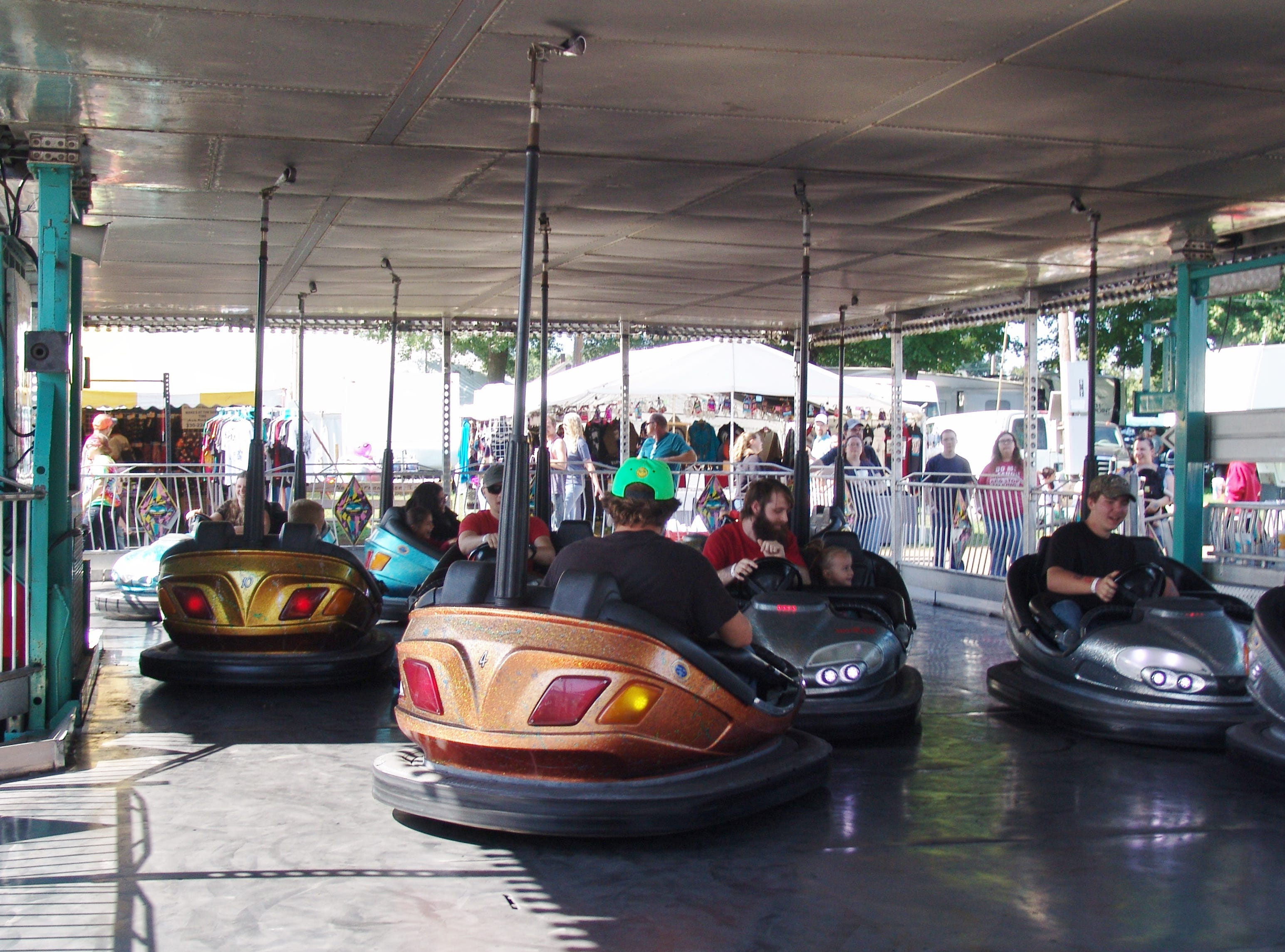 Fair goers ride the bumper cars Sunday at the Coshocton County Fair.