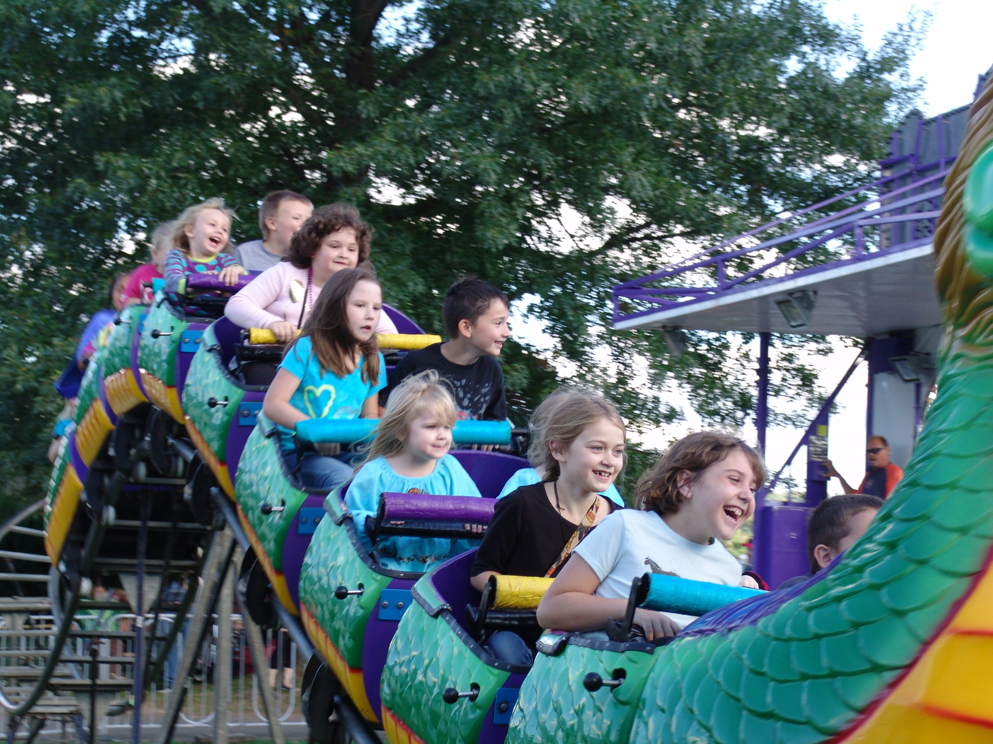Youngsters enjoy a ride on the Dragon Wagon Saturday evening at the Coshocton County Fair.