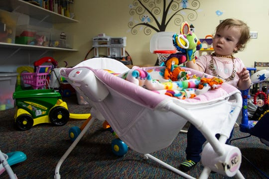 15-month-old Delilah Scrivner picks out a toy to play with on Monday, Oct. 1, 2018, at the Young Women's Resource Center in Des Moines.