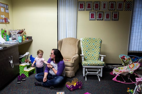 Rachel Scrivner, 20 of Osceola, spends time with her 15-month-old daughter Delilah on Monday, Oct. 1, 2018, at the Young Women's Resource Center in Des Moines.