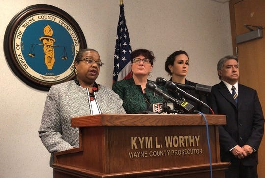Wayne County Prosecutor Kym Worthy stands alongside members of the prosecutor's office staff as she addresses the deaths of two men held in-custody in Wayne County jails, and announces charges in one of those cases at a press conference held at the Frank Murphy Hall of Justice on Monday, Oct. 1, 2018.