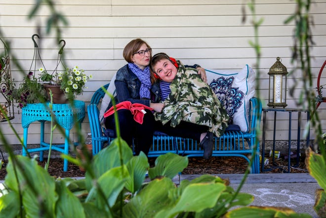 Laurie Kondek, of Northville takes a photo with her son Samuel on their front porch on Friday, Sept. 28, 2019.