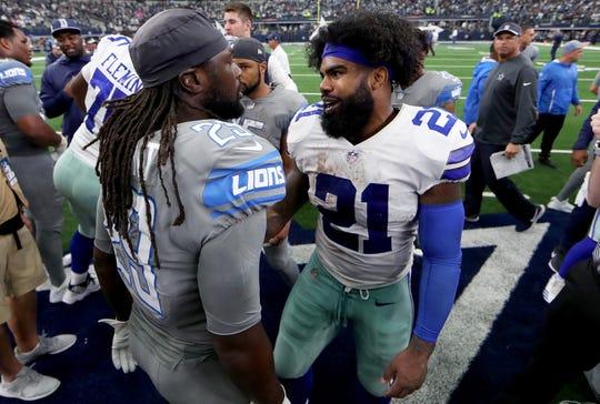 Ezekiel Elliott, right, greets LeGarrette Blount after the Dallas Cowboys beat the Detroit Lions, 26-24, at AT&T Stadium on Sept. 30, 2018 in Arlington, Texas.