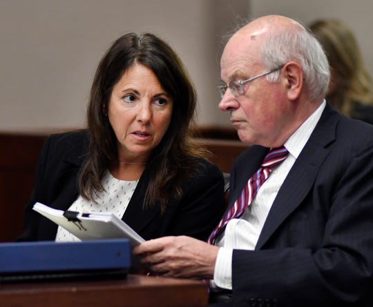 Livingston County Judge Theresa Brennan, left, talks with her attorney, Dennis Kolenda, during her judicial misconduct proceeding  at 16th District Court in Livonia.
