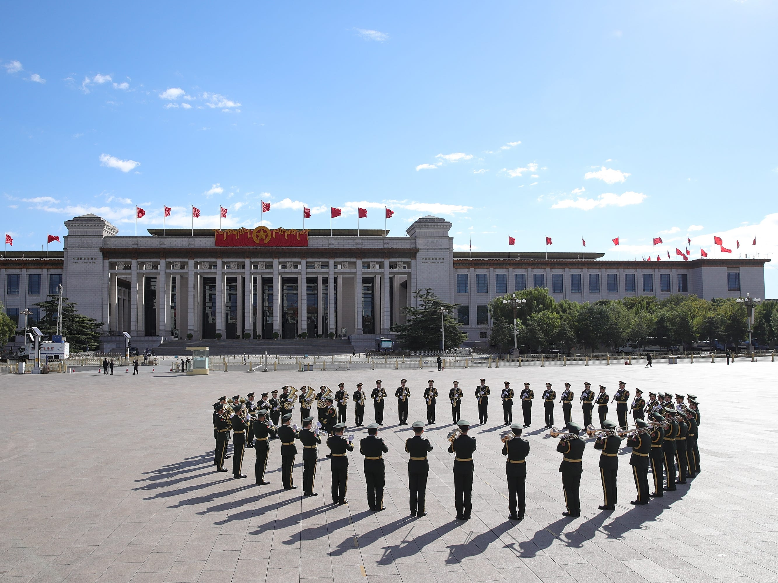 A military band rehearses before a ceremony at Tiananmen Square, on the eve of National Day on Sept. 30, 2018 in Beijing. On Oct. 1, 1949, Chinese leader Mao Zedong stood at the Tiananmen Rostrum to declare the founding of the People's Republic of China.