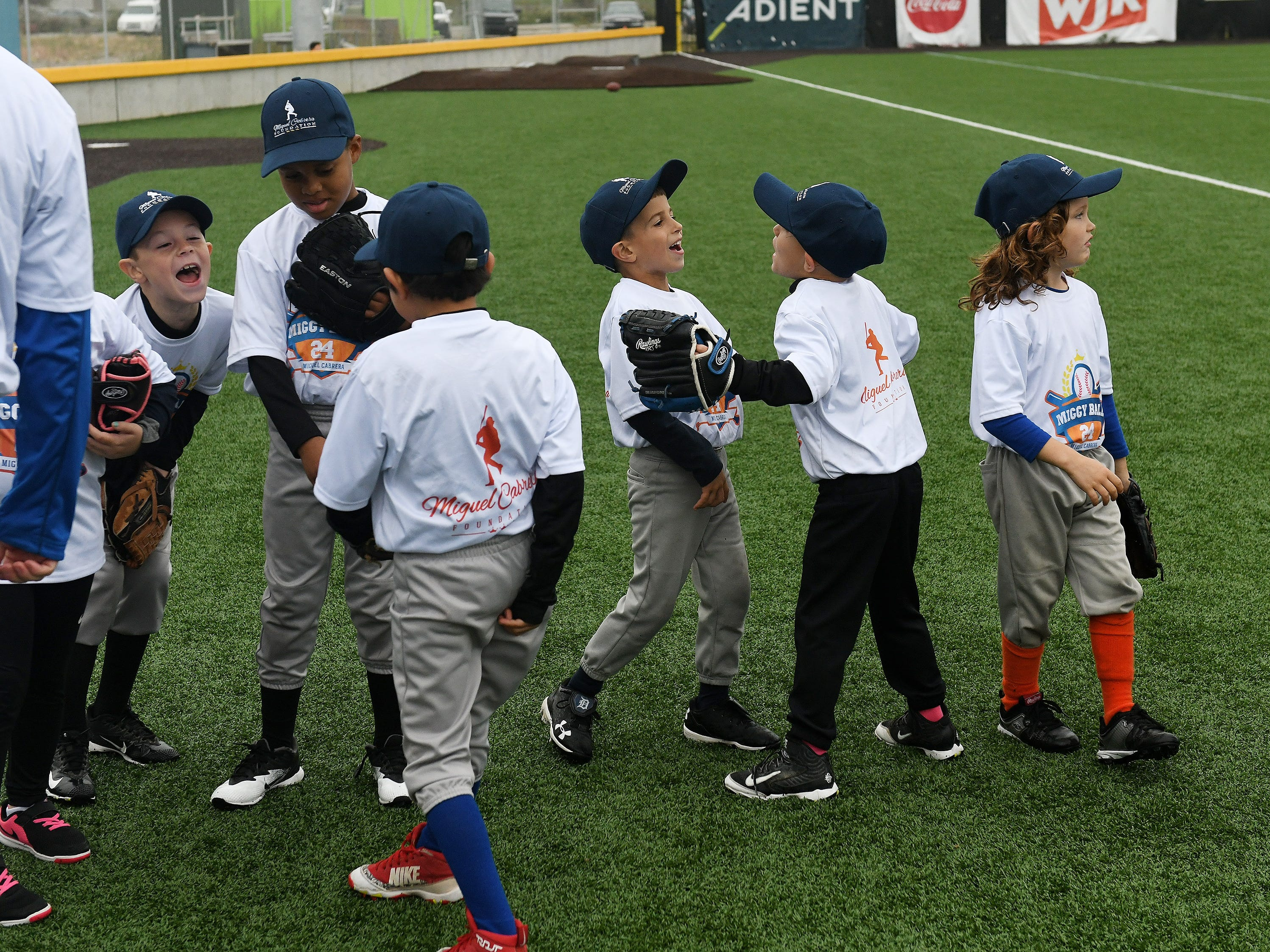Kids joke around while they wait their turn to perform skills at the Miggy Ball 24 event at The Corner Ballpark in Detroit on Oct 1, 2018. From right, Isaac Gourley, 6, of Detroit, Jackson McMahon, 5, and Evan Walter. Miggy Ball 24 is a recreation format where kids participate in five baseball skills.
