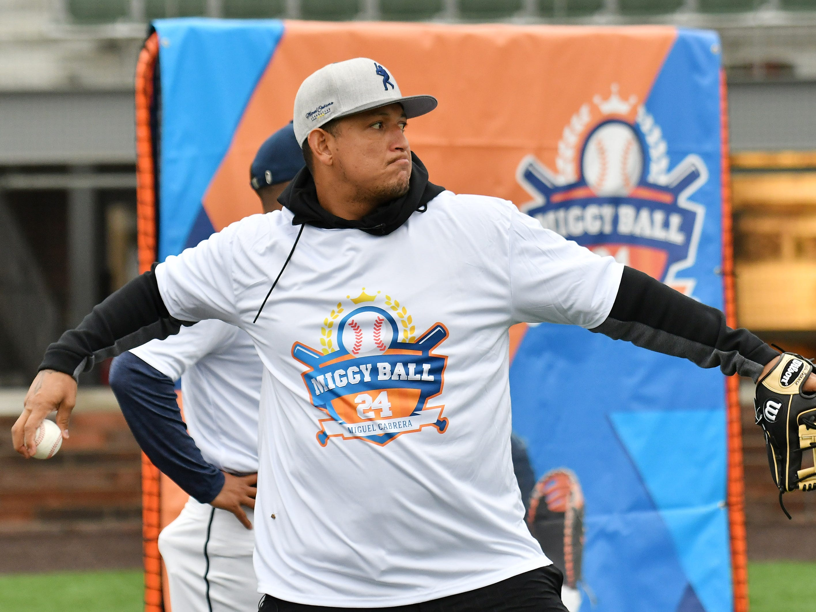 Tigers' Miguel Cabrera plays toss at the Miggy Ball 24 event.