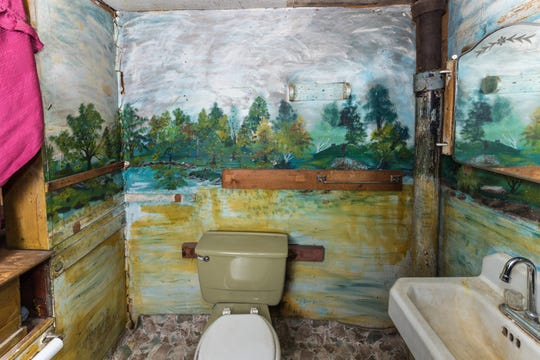 Big Flats artist Martha Robertshaw painted outdoor-themed murals in every room of her home, even the bathroom, to please her home-bound husband.