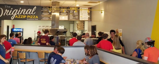 The West Side Azzip Pizza is the original location, and stays busy all afternoon.