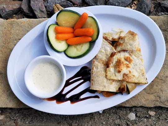 A grilled veggie Italiano sandwich in a half wrap with fresh vegetables and ranch dip. Anybody would be satisfied with this healthy lunch, vegan or not.