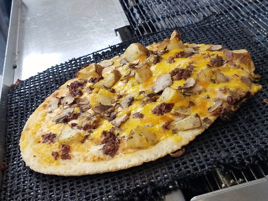 Another Azzip Specialty - the Mr. Potatohead pizza with roasted potatoes, bacon, ranch and cheddar cheese. You may choose a house pizza, or build your own.