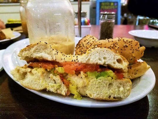 A vegan breakfast bagel at the Daily Grind, with tomato, avocado, and vegan cheese.